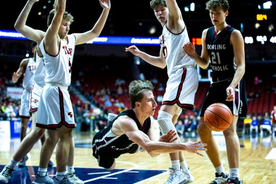 Dowling Catholic's Matt Stilwill falls while trying to make a pass during the Dowling Catholic vs. Cedar Falls boys' basketball state tournament Class 4A quarterfinal on Wednesday, March 11, 2020, at Wells Fargo Arena in Des Moines.
