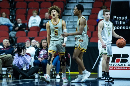 Ankeny's Braxton Bayless celebrates getting the extra shot after a foul during the Iowa City West vs. Ankeny boys' basketball state tournament Class 4A quarterfinal on Wednesday, March 11, 2020, at Wells Fargo Arena in Des Moines.