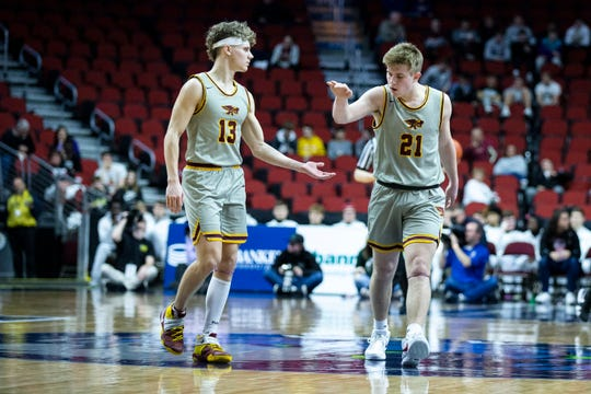 Ankeny's Jordan Kumm and Ankeny's Brecken Manus give each other five during the Iowa City West vs. Ankeny boys' basketball state tournament Class 4A quarterfinal on Wednesday, March 11, 2020, at Wells Fargo Arena in Des Moines.