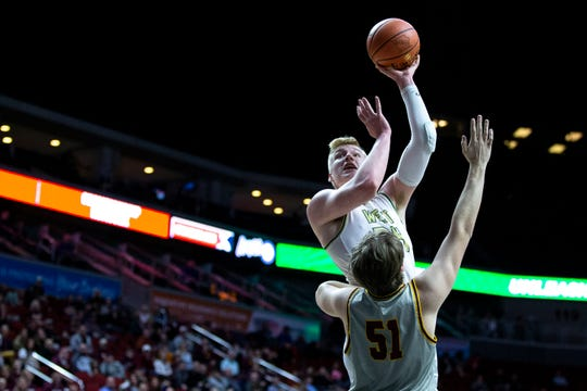 Iowa City West's  Even Brauns shoots the ball during the Iowa City West vs. Ankeny boys' basketball state tournament Class 4A quarterfinal on Wednesday, March 11, 2020, at Wells Fargo Arena in Des Moines.