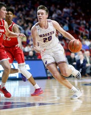 Waukee's Payton Sandfort drives to the basket during the 4A state basketball quarterfinal matchup at Wells Fargo Arena Tuesday, March 10, 2020.