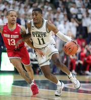 Michigan State's Aaron Henry drives against Ohio State's CJ Walker during the second half Sunday, March 8, 2020 at the Breslin Center in East Lansing.