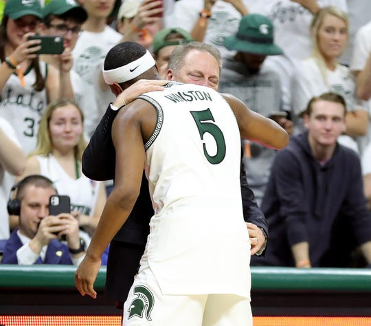 Tom Izzo hugs Cassius Winston, after he leaves the game on senior day at the end of Michigan State's 80-69 win against Ohio State, Sunday, March 8, 2020 at the Breslin Center in East Lansing.