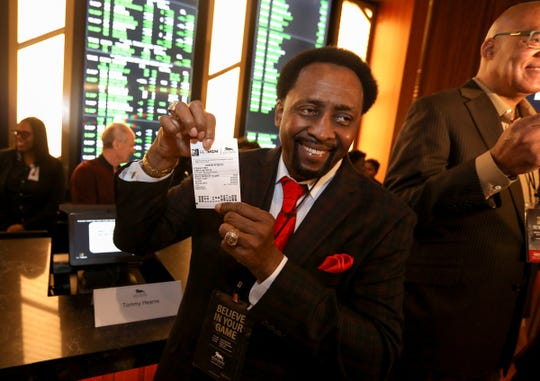 "Thomas ""the Hitman"" Hearns shows off his bet after the MGM Grand Detroit opened up its sports betting & entertainment venue called BetMGM Sports Lounge at its casino in Detroit, Michigan on Wednesday, March 11, 2020."