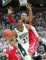 Michigan State's Xavier Tillman Sr. passes against Ohio State's Kaleb Wesson during the second half Sunday, March 8, 2020 at the Breslin Center in East Lansing.