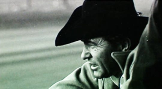 Carroll Shelby, automotive designer and race car driver, is the center of attention