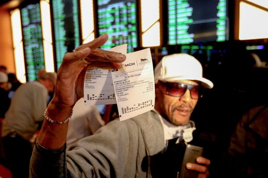 Gregory Ponders, 62 of Detroit shows off his betting ticket to the media during the grand opening of the MGM Grand Detroit sports betting & entertainment venue called BetMGM Sports Lounge at its casino in Detroit, Michigan on Wednesday, March 11, 2020.