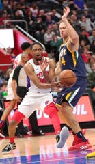 Detroit Pistons guard Brandon Knight passes against Utah Jazz forward Bojan Bogdanovic during the second half Saturday, March 7, 2020 at Little Caesars Arena.