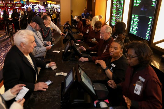 People placing bets in the MGM Grand Detroit new sports betting & entertainment venue called BetMGM Sports Lounge at its casino in Detroit, Michigan on Wednesday, March 11, 2020.