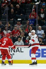 Carolina Hurricanes right wing Nino Niederreiter celebrates his second-period goal in front of Detroit Red Wings defenseman Alex Biega on Tuesday, March 10, 2020, in Detroit.