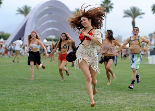 Festivalgoers running toward the main stage at the 2012 Coachella Valley Music and Arts Festival in Indio, Calif. on April 13, 2012. The Coachella music festival in Southern California has been postponed amid virus concerns.