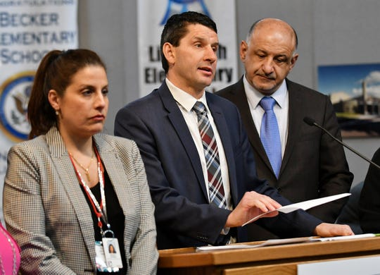 Maysam Alie-Bazzi, Dearborn Public Schools executive director of staff and students, left; district Superintendent Dr. Glenn Maleyko; and school board president Hussein Berry hold a news conference to announce the closing of Whitmore-Bolles Elementary School amid coronavirus concerns.