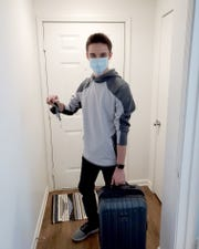 Michigan State University student Shad Soldano prepares to leave school and head home to Traverse City after university officials cancel in-person classes through April 20 due to coronavirus fears.