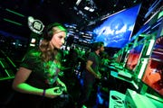 A gamer plays a new offering at Xbox E3 2018 Showcase in Los Angeles in this June 10, 2018, file photo. This year's E3, scheduled to take over the Los Angeles Convention Center in June, 2020, is being canceled due to coronavirus concerns.