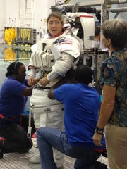 """Peggy Whitson, right, attends Koch's first spacewalk training. """"It is beyond an honor to follow in her footsteps today. I can't wait to pay it forward to the next explorers and watch them fly even higher,"""" Koch said."""
