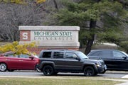 Students move from Michigan State University campus when the school moved to online-only classes.