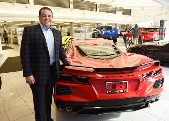 Weston Stanford, executive vice president at Les Stanford Chevrolet, poses with a 2020 Corvette inside the showroom.