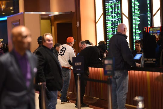 Bets are placed earlier this month at MGM Grand Detroit, which opened its sports book.