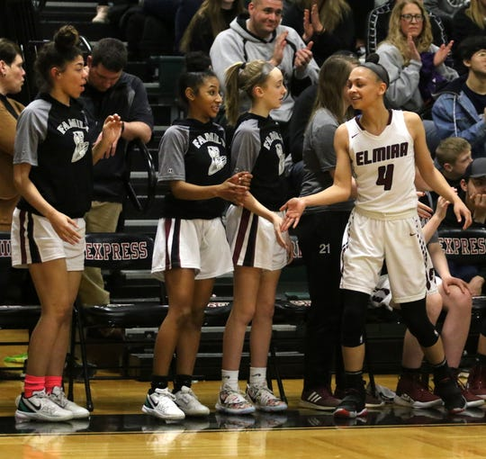 Elmira point guard Kiara Fisher (4) is congratulated by teammates after coming off the court late in the team's 70-50 win over Horseheads in the Section 4 Class AA championship game March 6, 2020 at Elmira High School.