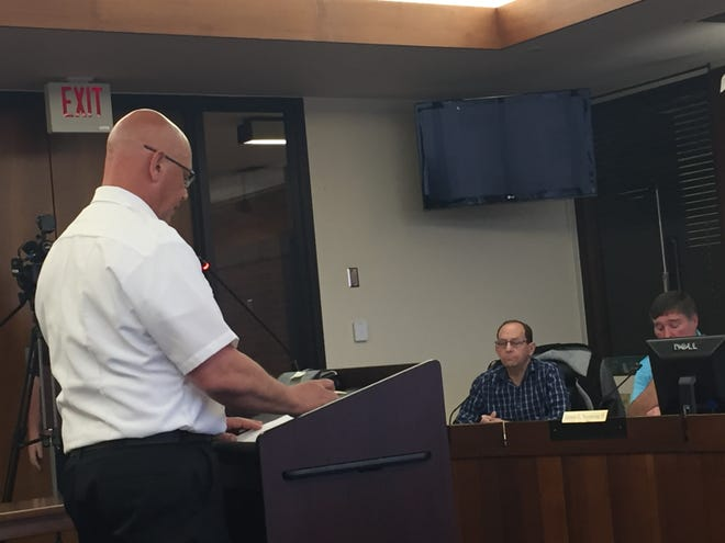 Evansville Fire Chief Mike Connelly, left, address the Fire Merit Commission on Tuesday. Listneing are commission members Jesse Storey and James Nunning.