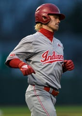 Indiana's Drew Ashley (3) walks to first base during the second inning against the University of Evansville Purple Aces at the newly renovated German American Bank Field at Charles H. Braun Stadium in Evansville, Ind., Tuesday, March 10, 2020. The Purple Aces defeated the Hoosiers, 5-4.