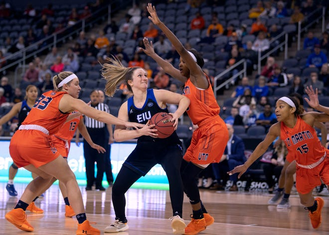 Eastern Illinois's Abby Wahl (41) drives towards the basket past UT Martin's Demi Burdick (33) and UT Martin's Chelsey Perry (20) during their semifinal game of the Ohio Valley Conference Basketball Championships at the Ford Center in Evansville, Ind., Friday afternoon, March 6, 2020.