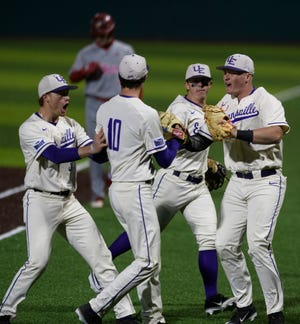 The University of Evansville Purple Aces celebrate as their team switches to hitting in the eighth inning against the Indiana Hoosiers at the newly renovated German American Bank Field at Charles H. Braun Stadium in Evansville, Ind., Tuesday, March 10, 2020. The Purple Aces defeated the Hoosiers, 5-4.