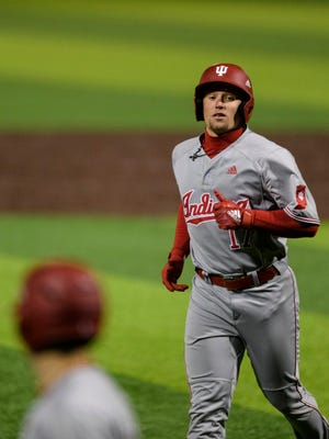 Indiana's Elijah Dunham, a Reitz graduate, walks off the field during the Hoosiers' 5-4 loss to UE on March 10 at Braun Stadium.