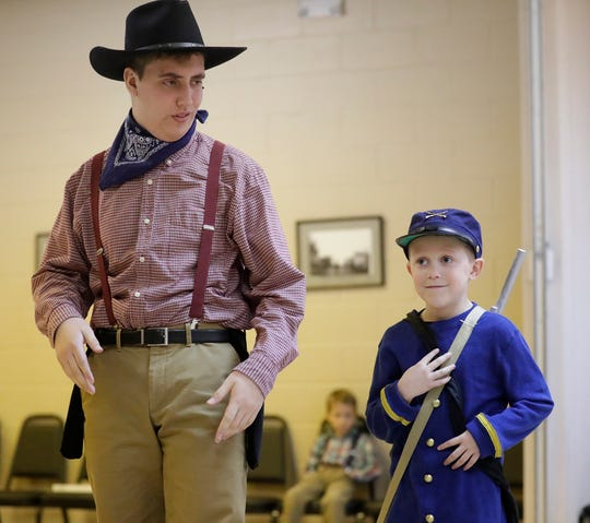 """Homeschool Performing Arts Club members David Rutherford and Ian Koenigs rehearse their play """"Wagon Wheels a-Rollin'"""" at the Eden Community Center in Eden. The play runs March 20 and 21 at the University of Wisconsin-Oshkosh Fond du Lac campus Prairie Theater."""