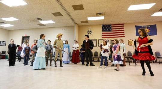 """Homeschool Performing Arts Club members rehearse their play """"Wagon Wheels a-Rollin'"""" at the Eden Community Center in Eden. The play runs March 20 and 21 at the University of Wisconsin-Oshkosh Fond du Lac campus Prairie Theater."""