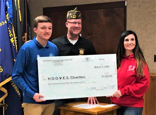 Bryson Fox, left, raised $526 for Healing of Our Veterans Equine Service (Hooves). The VFW Post 2947 matched his donation with Jeff Fox center and Amanda Held, HOOVES founder receiving the check.