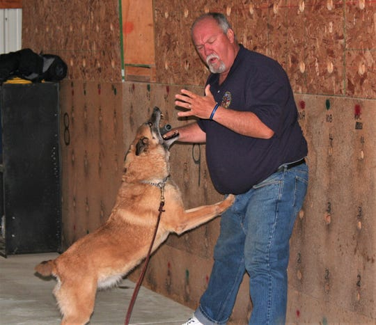 Brian Woods demonstrations a training exercise for a police K9.