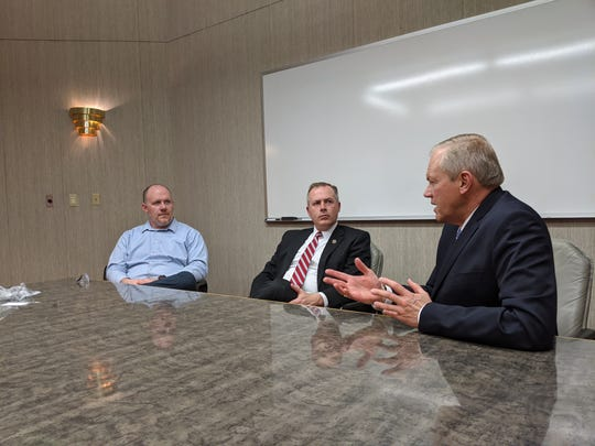 Bill Reineke, Ohio 88th District representative, right, speaks with Ohio Treasurer Robert Sprague, center, and and Tom Conrad of Crescent Manufacturing about the need to support skilled trades.