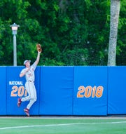 Seminoles Robby Martin (26) makes the catch at the wall against the Gators, Tuesday, March 10, 2020 at McKethan Stadium in Gainesville.