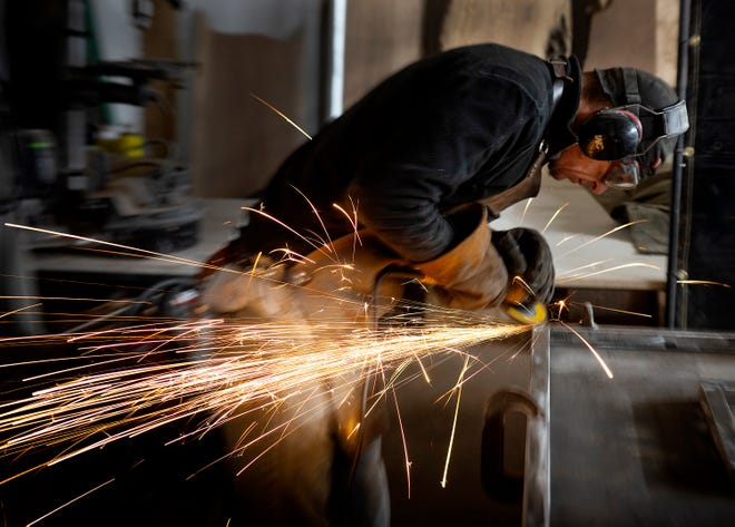 David Novak works on a metal frame at his workspace near Dacusville in Pickens County.