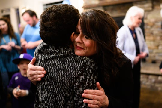 Angie Lewis hugs supporters after her husband, Greenville County Sheriff candidate Hobart Lewis, gave his victory speech during his election night watch part Tuesday, March 10, 2020.