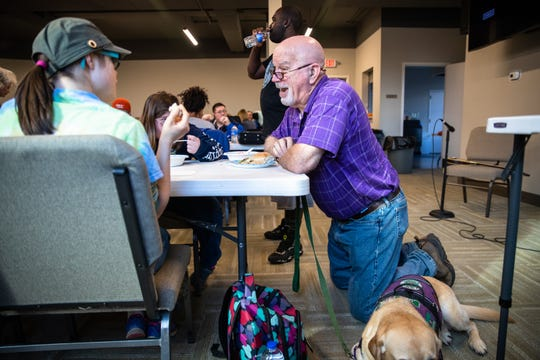 """Robert """"Skeeter"""" Powell, founder of David's Table,la nonprofit providing resources for teens and young adults with disabilities, chats with members during dinner during a Monday Club session at Rocky Creek Baptist Church Monday, March 9, 2020."""