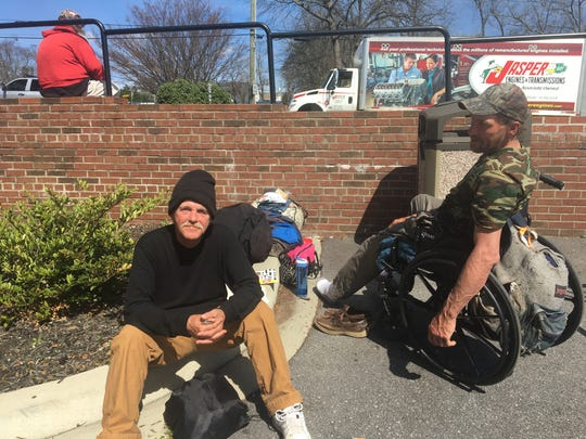 Randy Byran (left) and John Rorabaugh (right) sit outside of Triune Mercy Center on Stone Avenue.