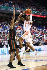 Mar 11, 2020; Greensboro, North Carolina, USA; Clemson Tigers guard Al-Amir Dawes (2) goes up for a shot against Miami (Fl) Hurricanes forward Keith Stone (4) during the second half at Greensboro Coliseum. Mandatory Credit: Jeremy Brevard-USA TODAY Sports