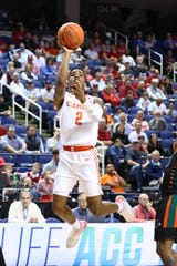 Mar 11, 2020; Greensboro, North Carolina, USA; Clemson Tigers guard Al-Amir Dawes (2) goes up for a shot against the Miami (Fl) Hurricanes during the second half at Greensboro Coliseum. Mandatory Credit: Jeremy Brevard-USA TODAY Sports