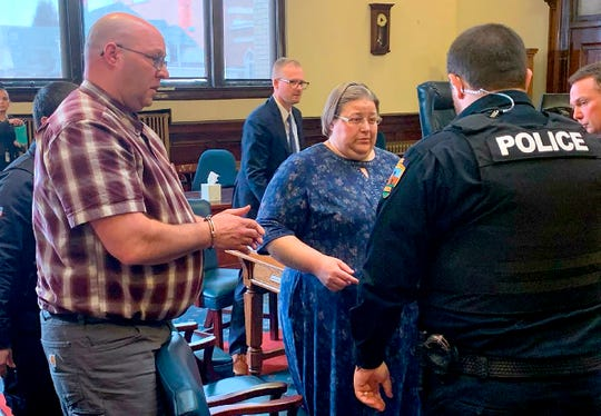 In this Monday, March 9, 2020 photo, Jonathan James Hay, left, and Debra Ann Hay, center, are led out of district court after they were sentenced to 13 years in prison for abusing their adopted 12-year-old son while living in Butte.