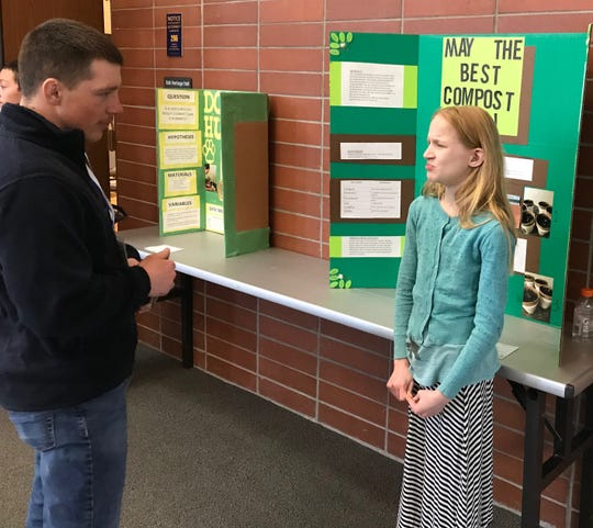 Mylah Flaten, a fifth-grader at Belt Elementary, tested compost for her project at the Montana Region II Science and Engineering Fair at Great Falls College on Tuesday.
