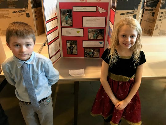 Landon Johnson and Emma Shimerdla, third-graders at Belt Elementary, experimented to see what papers are best to make paper airplanes for their project at the Montana Region II Science and Engineering Fair on Tuesday at Great Falls College.