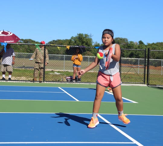 Lefty Payton Escobar hits a forehand in her match at the 2020 Calvo's SelectCare Grand Prix tennis tournament, which concluded five weeks of play at the Guam National Tennis Center in Dededo.