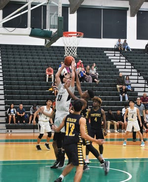 Harvest Christian Academy forward No. 33 Joe Henderson goes up strong to the basket in his semifinal game against the Guam High Panthers Wednesday night at the University of Guam Calvo Field House