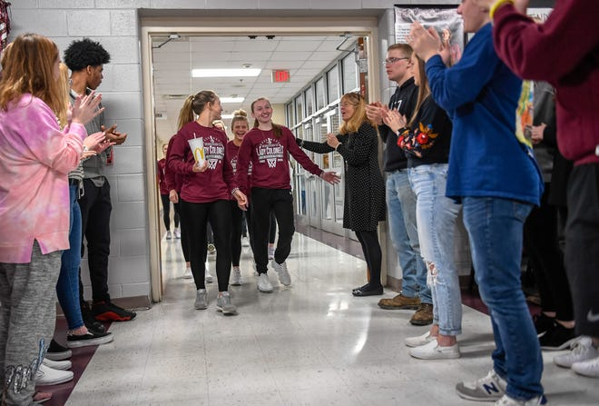 Students line the main hallway at Henderson County High for a send-off  for the Lady Colonels' trip tto he Sweet Sixteen tournament in Lexington Wednesday, March 11, 2020.