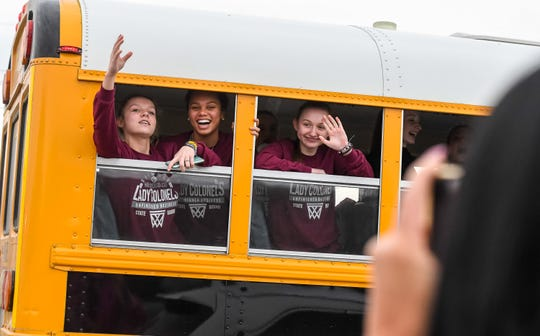 Teammates wave as the bus leaves for the Lady Colonels' trip to the Sweet Sixteen tournament in Lexington Wednesday, March 11, 2020.