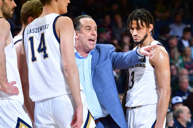 Mar 7, 2020; South Bend, Indiana, USA; Notre Dame Fighting Irish head coach Mike Brey talks to his players during a timeout in the first half against the Virginia Tech Hokies at the Purcell Pavilion.