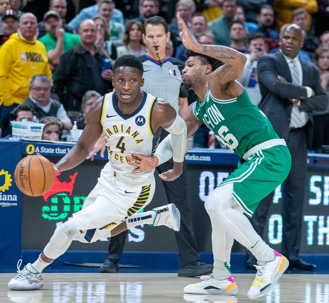 Victor Oladipo of the Indiana Pacers works around Marcus Smart of the Boston Celtics, Bankers Life Fieldhouse, Indianapolis, March 10, 2020. Boston won the contest 114-111.