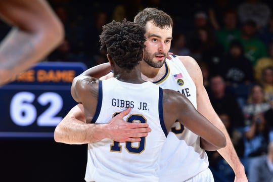 Mar 7, 2020; South Bend, Indiana, USA; Notre Dame Fighting Irish guard T.J. Gibbs (10) and forward John Mooney (33) hug shortly before they left the game in the second half against the Virginia Tech Hokies at the Purcell Pavilion. It was their last regular season home game as seniors.  Sports